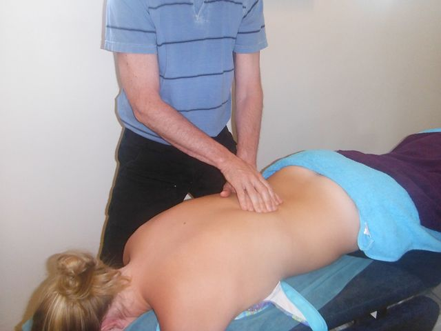 Chiropractor Norwest checking a patient's back