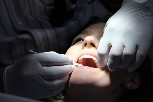 patient getting her teeth checked by a Willoughby dentist